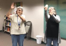 Photo taken during Signs of the Spirit meeting. We are learning signs for a song.